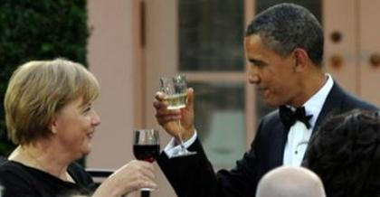 obama merkel wine toast
